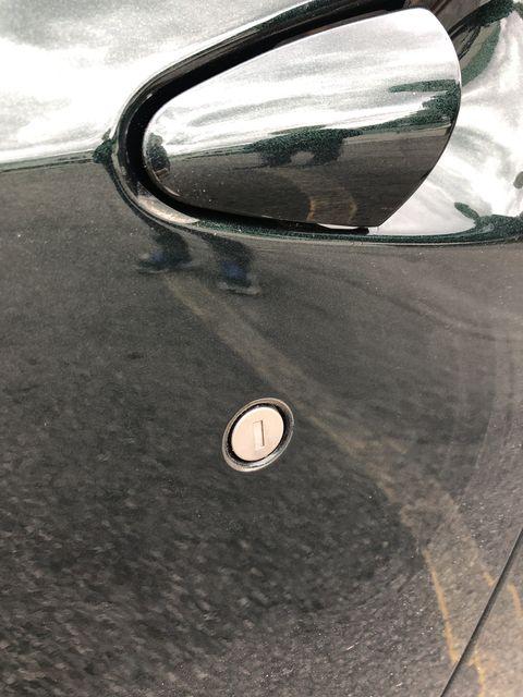 Automotive mirror, Automotive design, Glass, Reflection, Vehicle door, Automotive side-view mirror, Rear-view mirror, Automotive exterior, Light, Tints and shades,