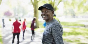 Portrait confident, happy senior man walking sports race in park