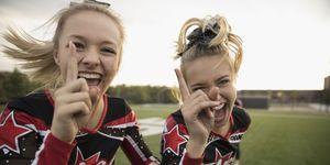 Portrait enthusiastic teenage girl high school cheerleading team gesturing, celebrating