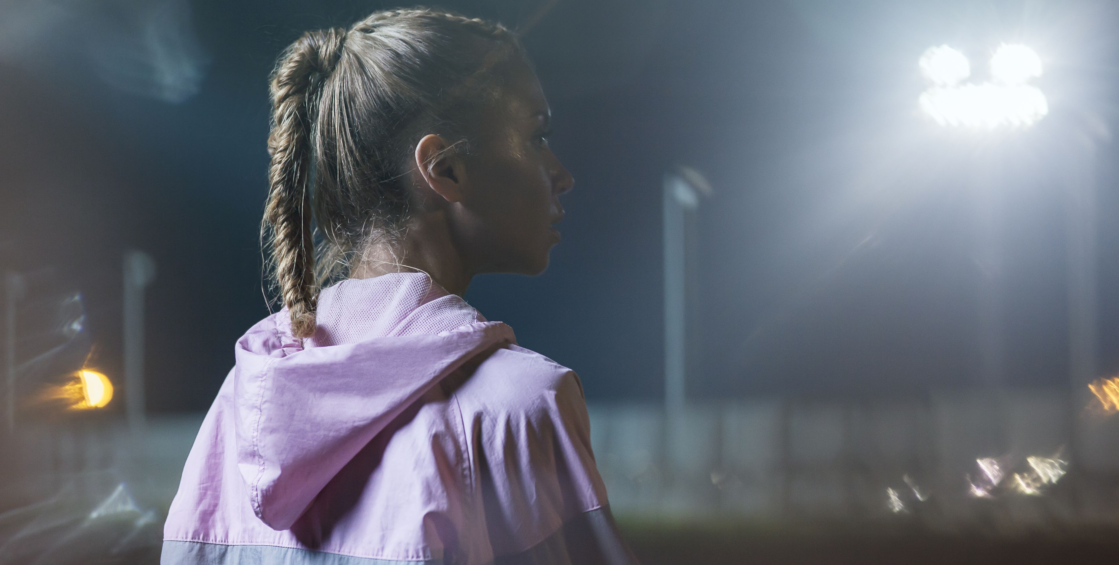 Portrait of a female urban runner at night