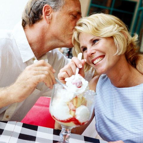 winter date ideas - a mature couple sharing a sundae