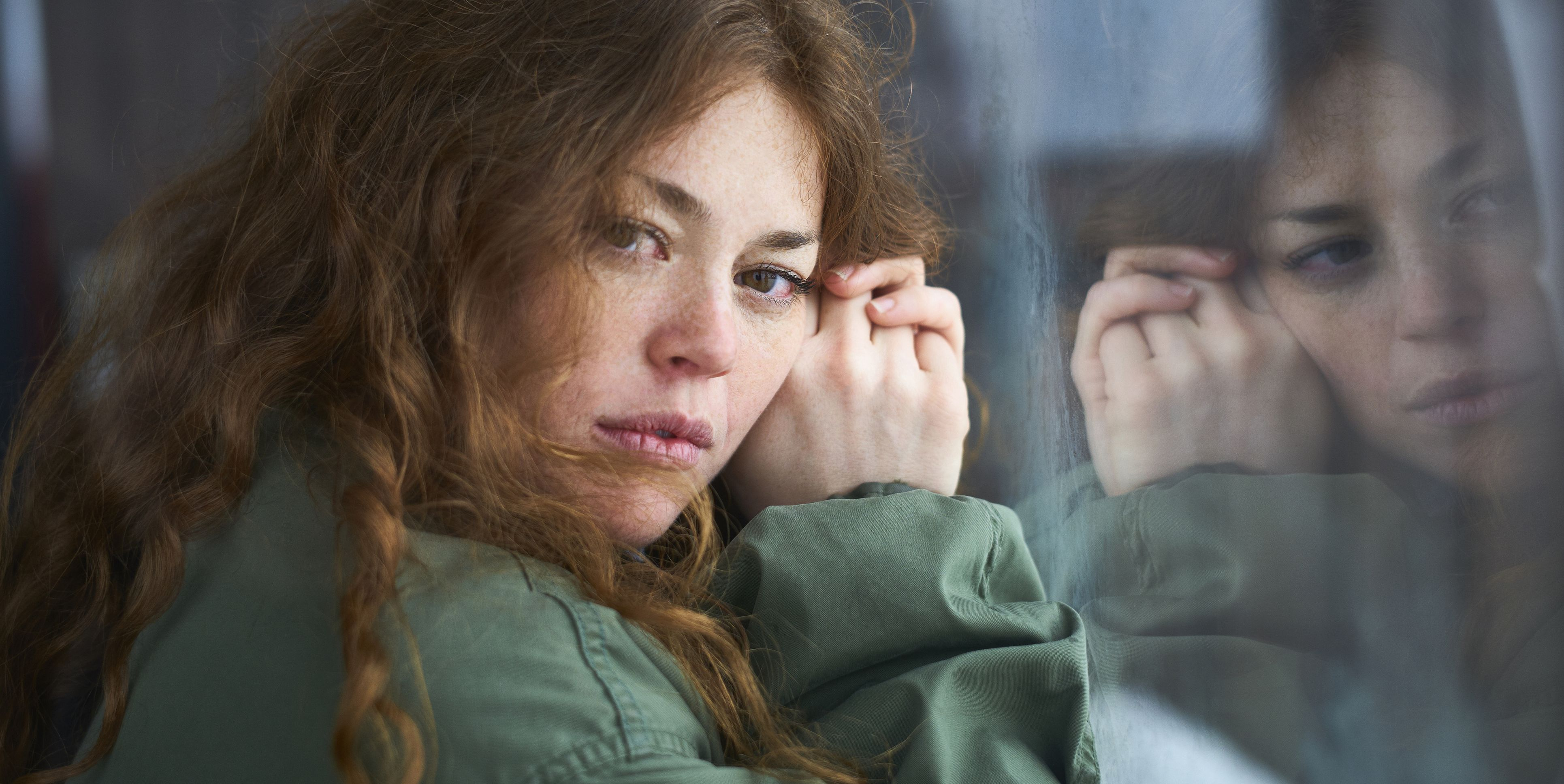 Portrait of a woman looking pensive into camera