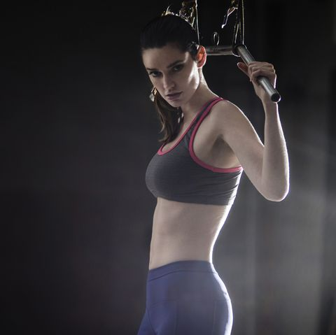 Portrait of a young woman strength training