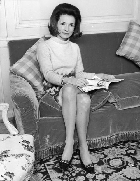 Lee Radziwill sitting on a couch, 1960s.
