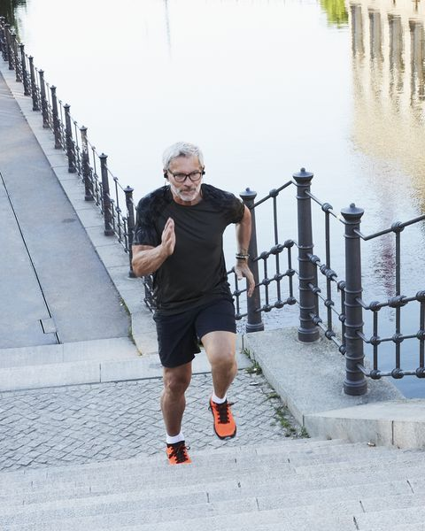portrait of an active senior man doing exercise in the city of berlin