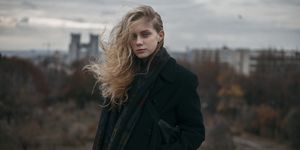 Portrait of Caucasian woman with hair blowing in wind