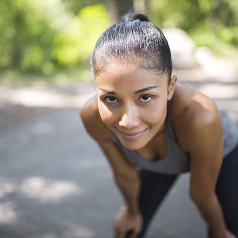 portrait of confident female athlete relaxing