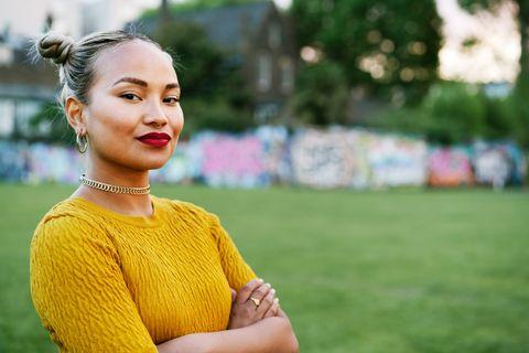 portrait of confident woman in city park