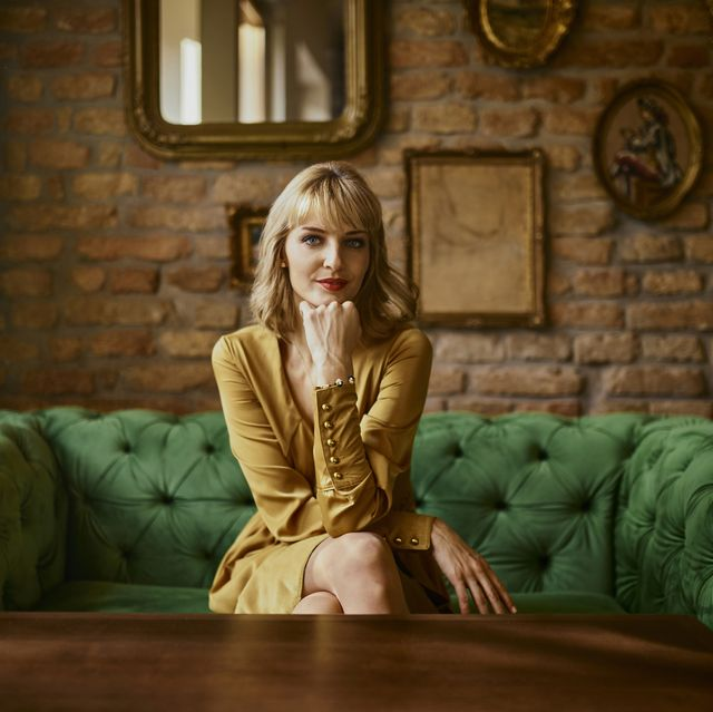 portrait of elegant woman sitting on a couch