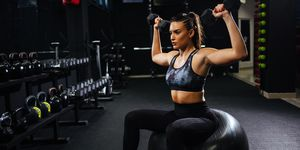 Portrait of female doing bicep exercises with dumbbell
