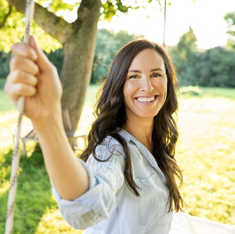 portrait of happy mature woman in garden