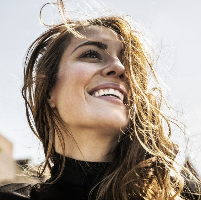 Portrait of happy woman with blowing hair