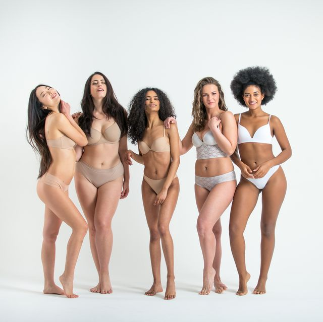 portrait of multi ethnic women in lingerie against white background