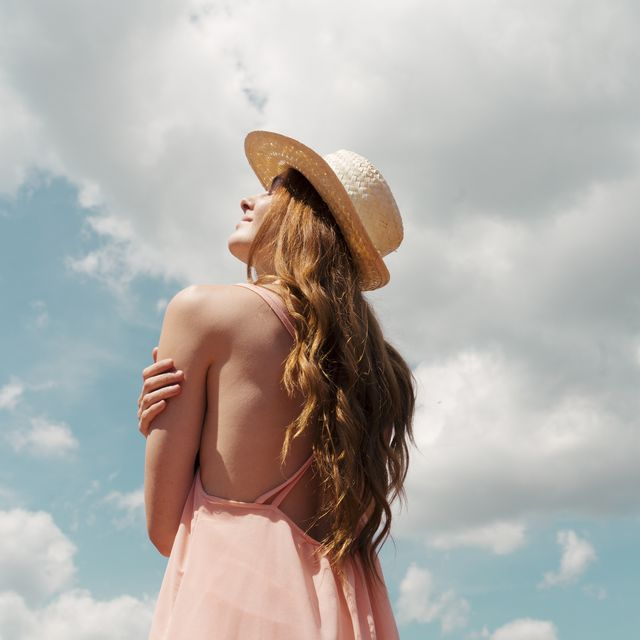 portrait of redheaded woman enjoying sunlight