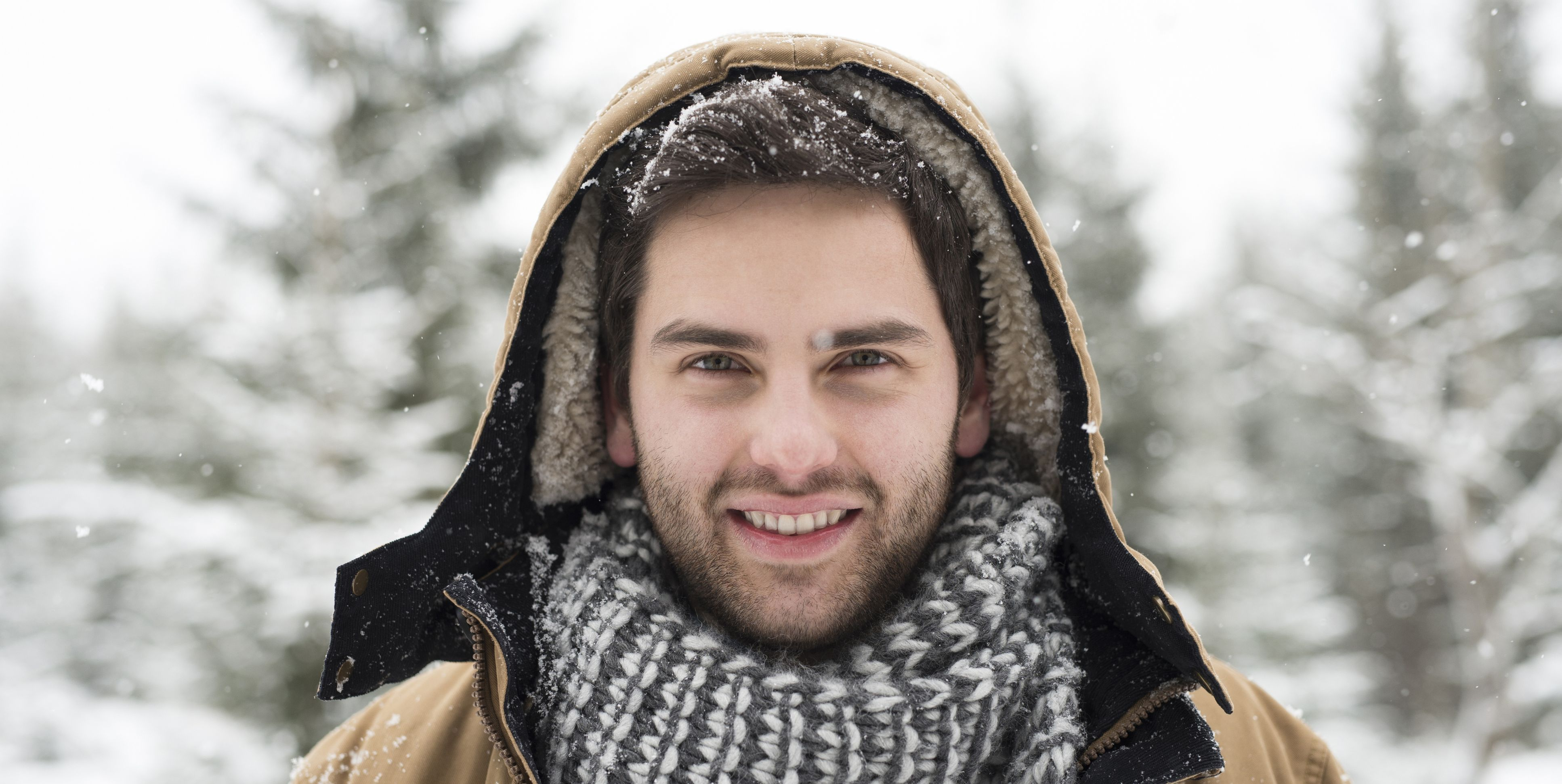 Portrait of smiling young man in winter