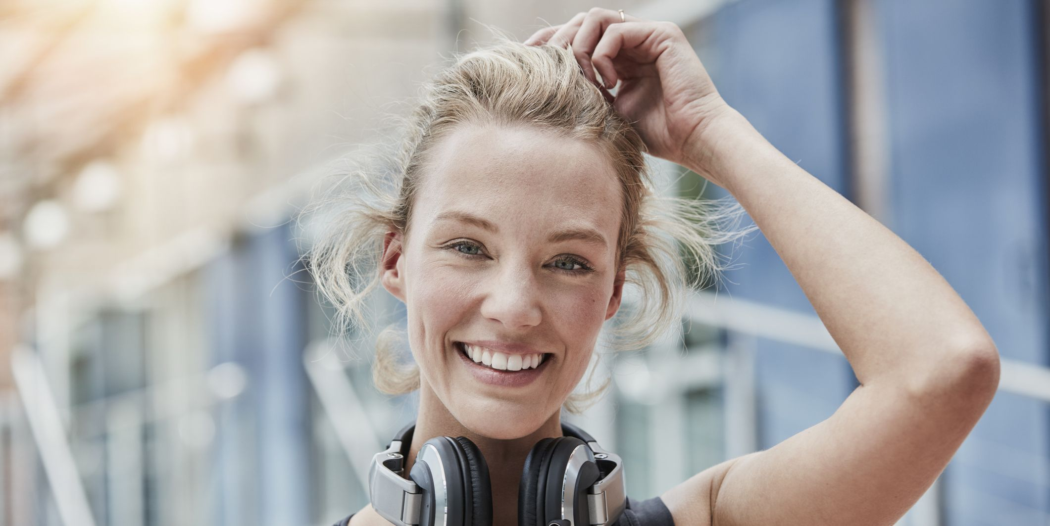 Portrait of smiling young woman with headphones