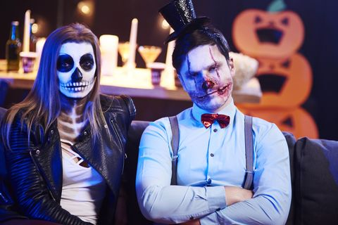 Portrait of spooky couple at Halloween party
