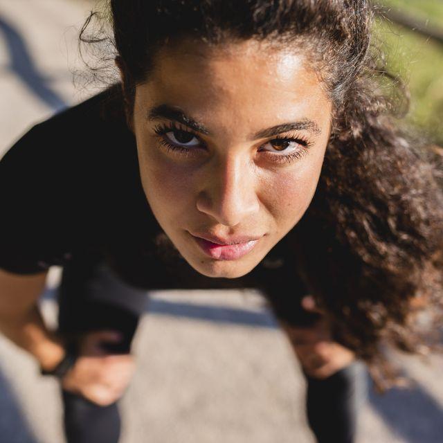 portrait of sportive young woman having a break