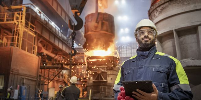 portrait of steelworker during steel pour in steelworks