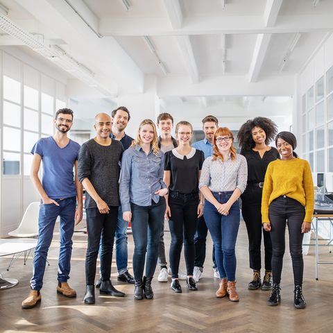 millennial definition -Portrait of successful business team