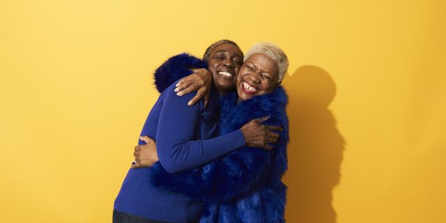portrait of two mature women dancing and having fun together