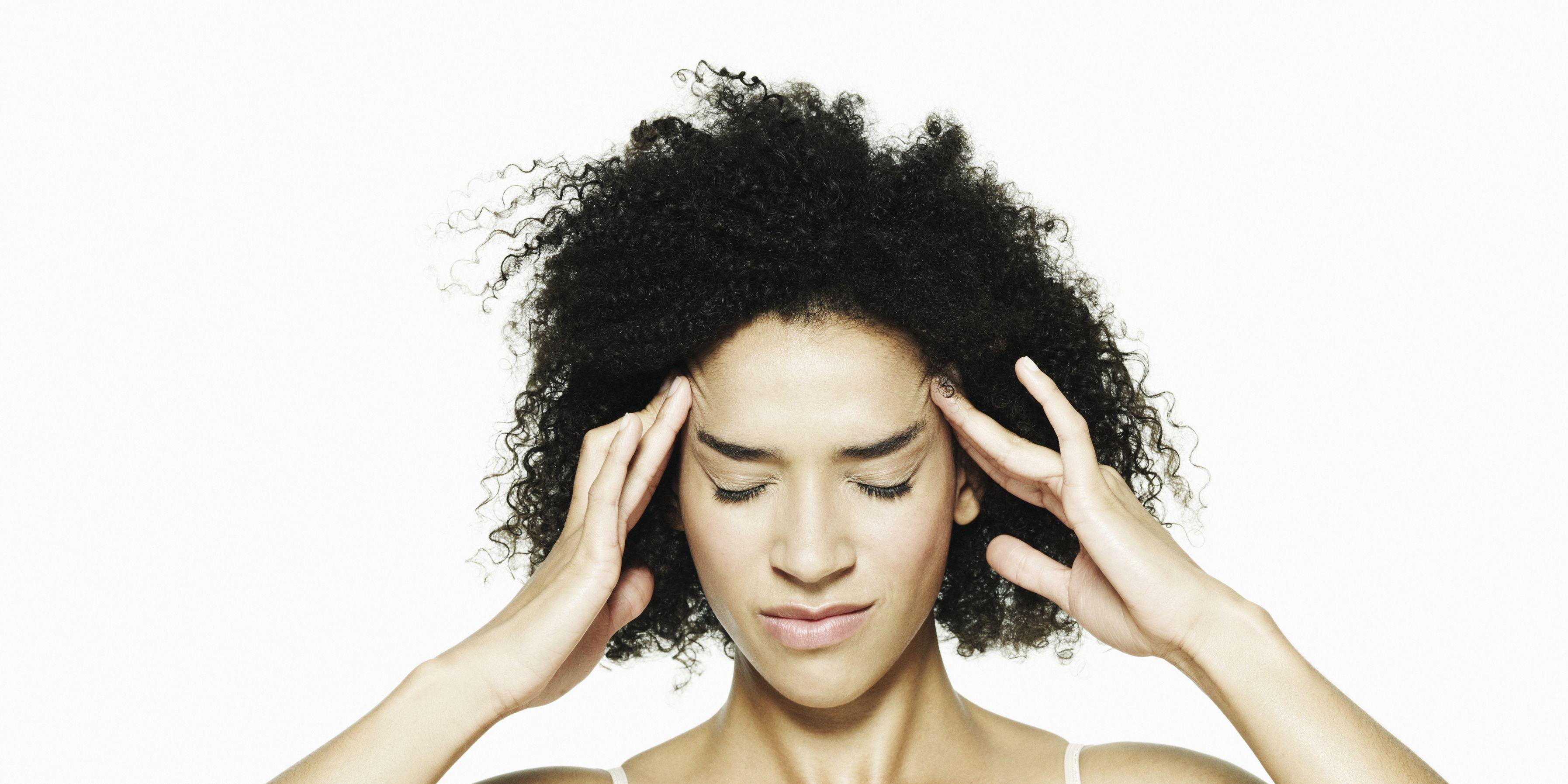 Portrait of woman with a headache