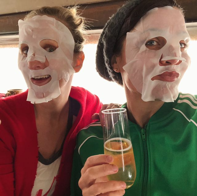 portrait of women wearing facial mask while holding drinks