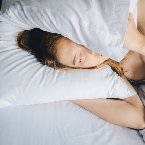 portrait of young beautiful asian woman hate to waking up in the morning