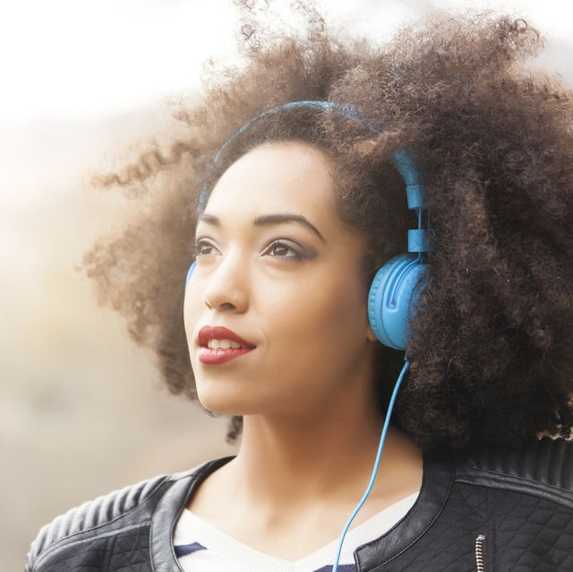 Portrait of young woman with blue headphones