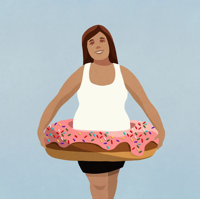 portrait overweight woman wearing inflatable donut ring