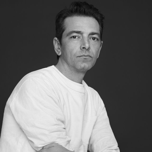 black and white portrait of pieter he wears a white long sleeved shirt