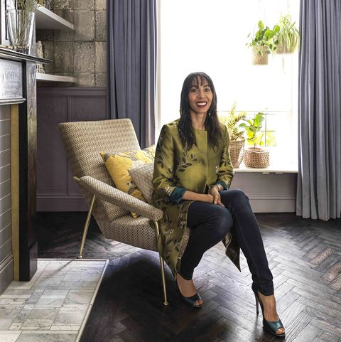 michelle sits on her 'd1531' chair by gio ponti for molteni  c, upholstered in rubelli's 'puntegiato' fabric, also designed by ponti