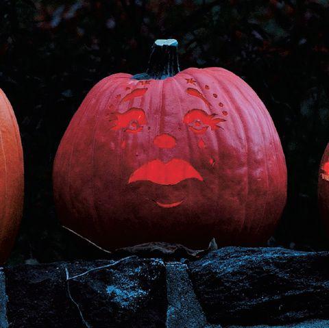 portraits on a pumpkin