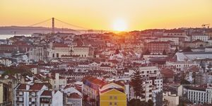 Portugal, Lisbon, View from Miradouro da Igreja da Graca, cityscape at sunset