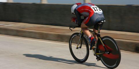 Man riding road bike in aero cycling kit