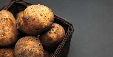 potatoes on a wooden board