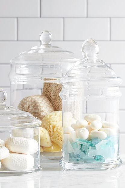 glass jars with soaps in them