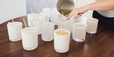 pouring wax into candle jars candle making process