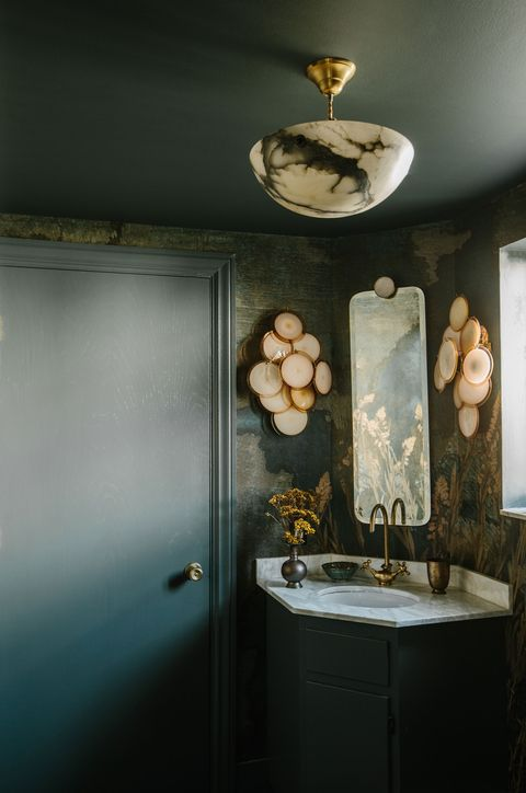 green powder room with brass