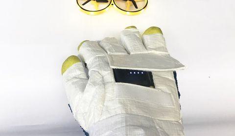 Yellow, Footwear, Glove, Hand, Font, Finger, Shoe, Fashion accessory, Glasses,