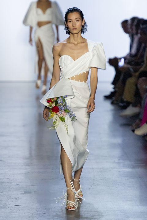 Fashion model, Fashion, Clothing, White, Runway, Shoulder, Fashion show, Dress, Waist, Haute couture,
