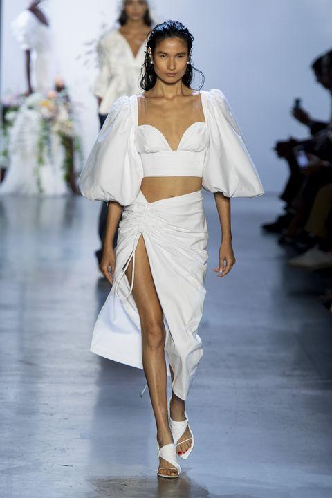 Fashion model, Fashion, White, Runway, Fashion show, Clothing, Shoulder, Haute couture, Waist, Dress,