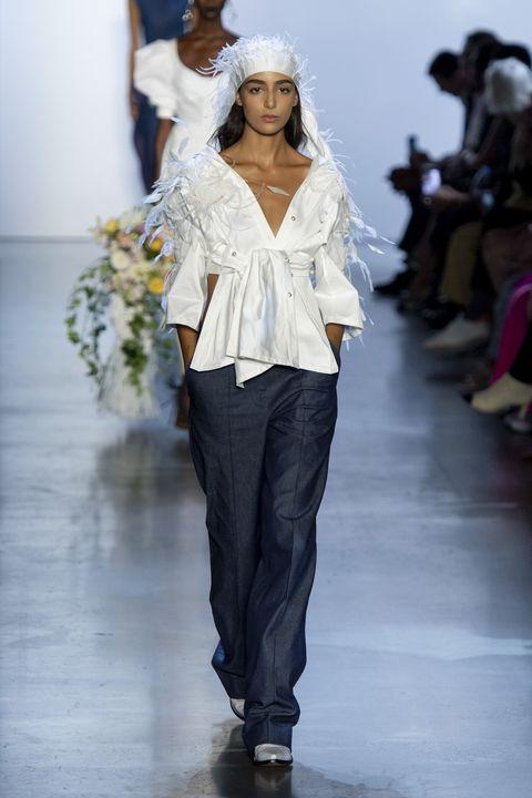 Fashion model, Runway, Fashion, White, Fashion show, Clothing, Shoulder, Joint, Waist, Fashion design,