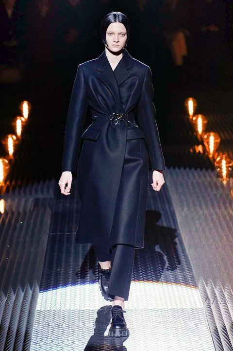 Fashion, Fashion model, Fashion show, Runway, Clothing, Coat, Overcoat, Human, Outerwear, Haute couture,