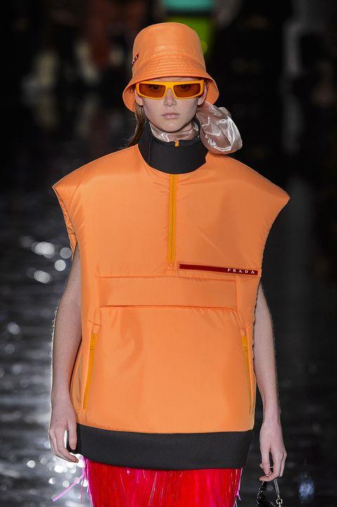 Fashion, Orange, Fashion show, Runway, Yellow, Fashion model, Eyewear, Outerwear, Fashion design, Neck,