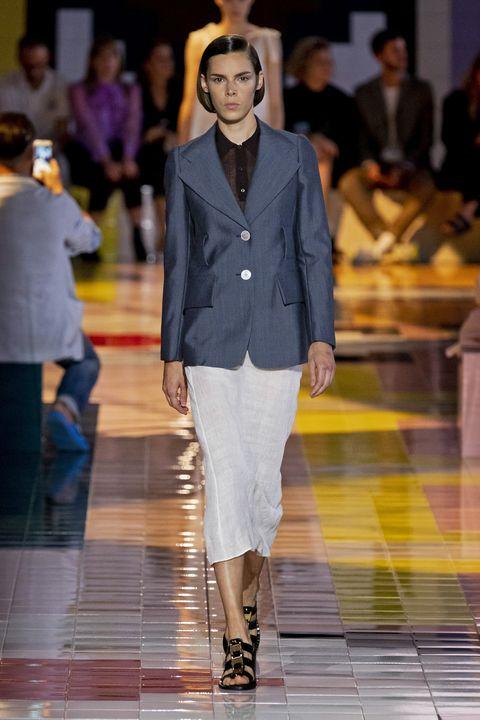 Fashion, Fashion model, Runway, Fashion show, Clothing, Blazer, Outerwear, Footwear, Yellow, Suit,