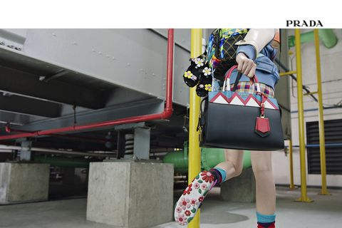 Bag, Fictional character, Concrete, Street fashion, Knee, Composite material, Baggage, Sock,