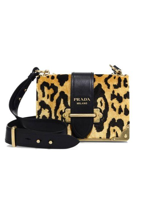 Handbag, Bag, Fashion accessory, Shoulder bag, Yellow, Beige, Leather, Material property, Wristlet, Strap,