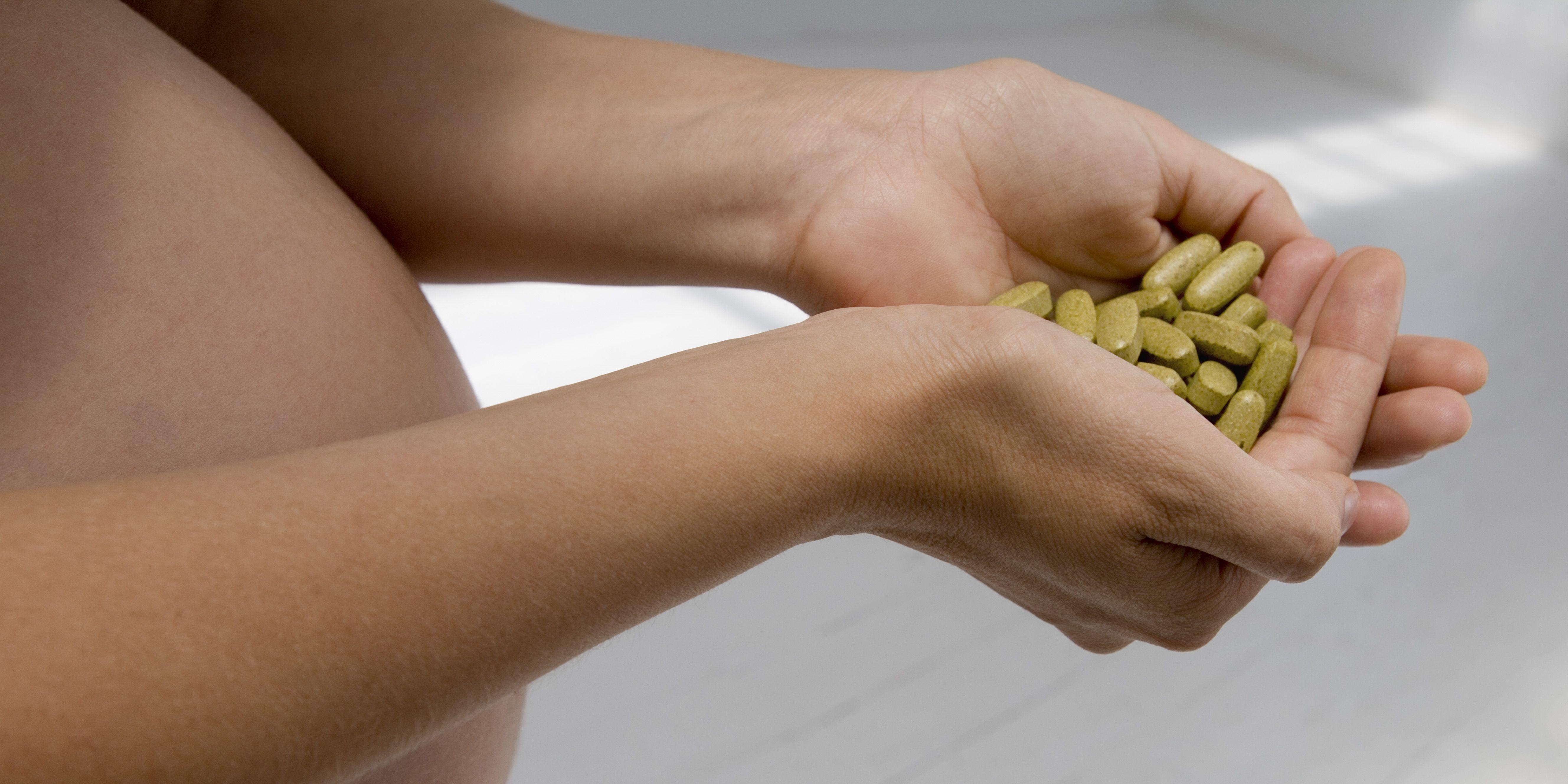 Pregnant woman holding pills