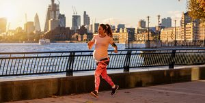 Pregnant woman runs along the Thames river in London